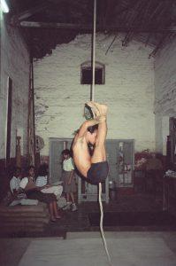 Simon Borg-Olivier practicing Urdhva mukha pascimotanasa on rope Mallakhamb in Pune, India, 1988